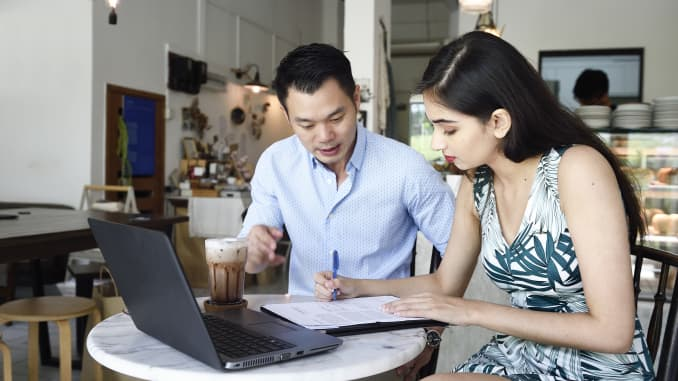 Financial advisor helping a client with paperwork