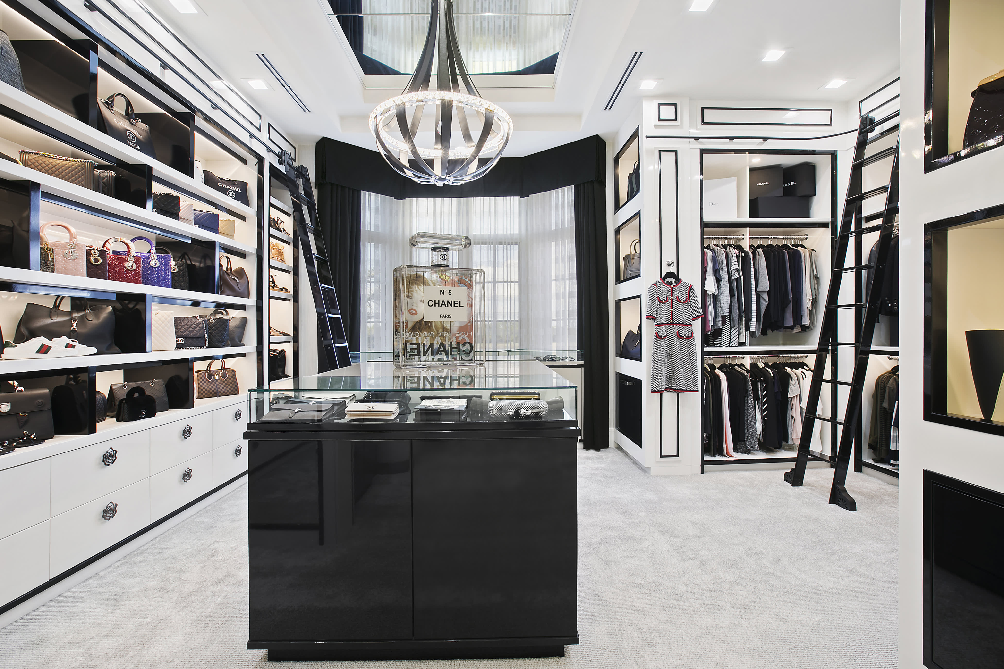 See inside 9 over-the-top closets, including one that's three levels and has its own champagne bar