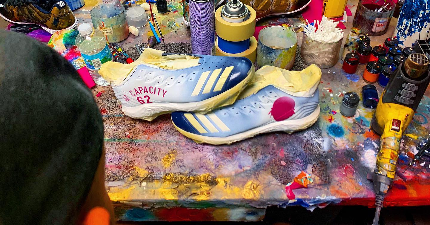 35 year old artist who paints custom shoes for NFL, NBA athletes
