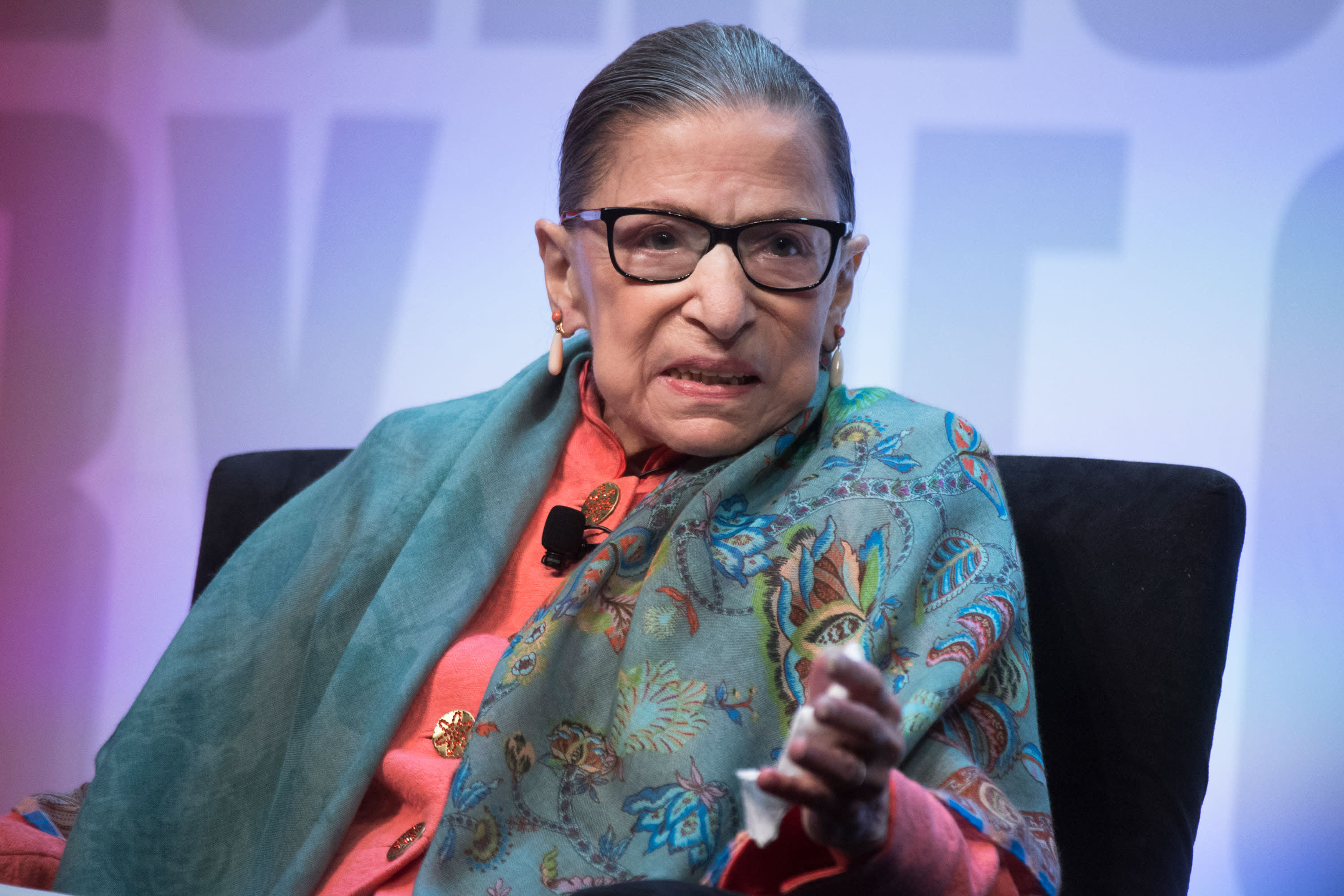 Justice Ruth Bader Ginsburg sits out Supreme Court arguments due to a stomach bug
