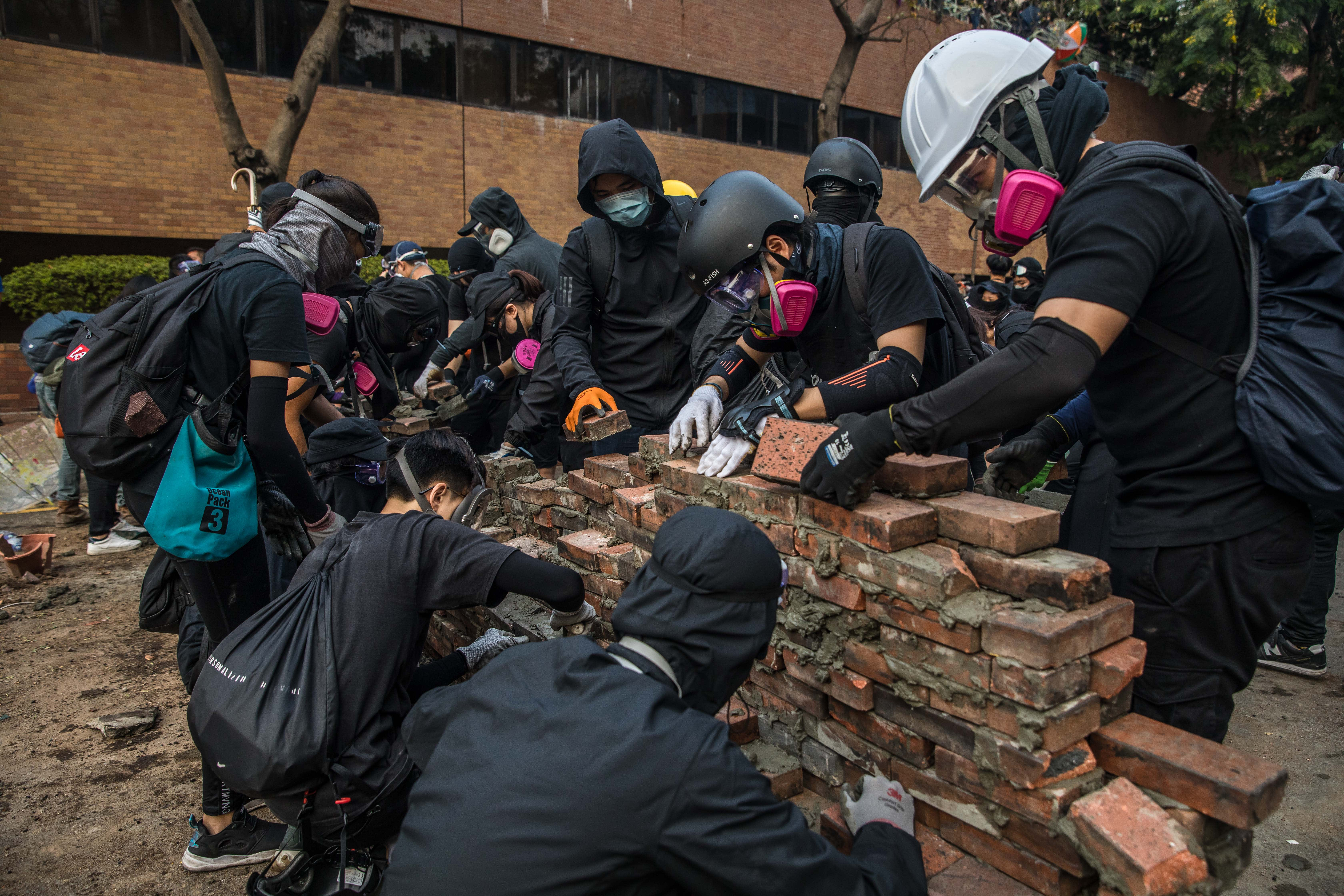 Hong Kong and China condemn attack on justice secretary as protests paralyze city