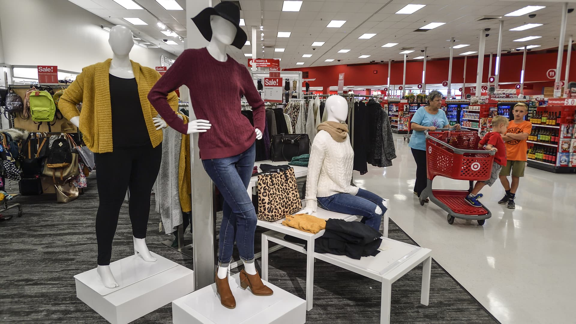 An increased number of mannequins feature clothing and shoes throughout the remodeled Target store in Orange, California.