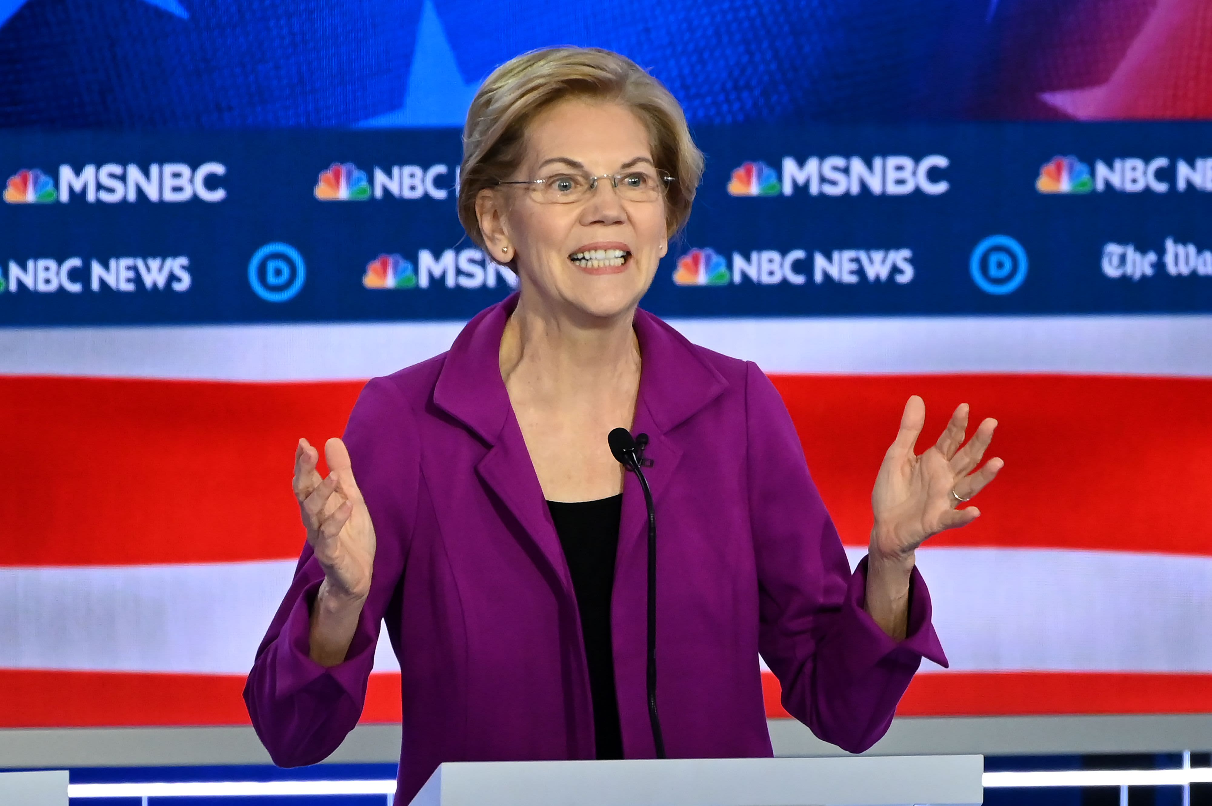 Elizabeth Warren pushes her wealth tax plan as a way to unite the country during Democratic primary debate
