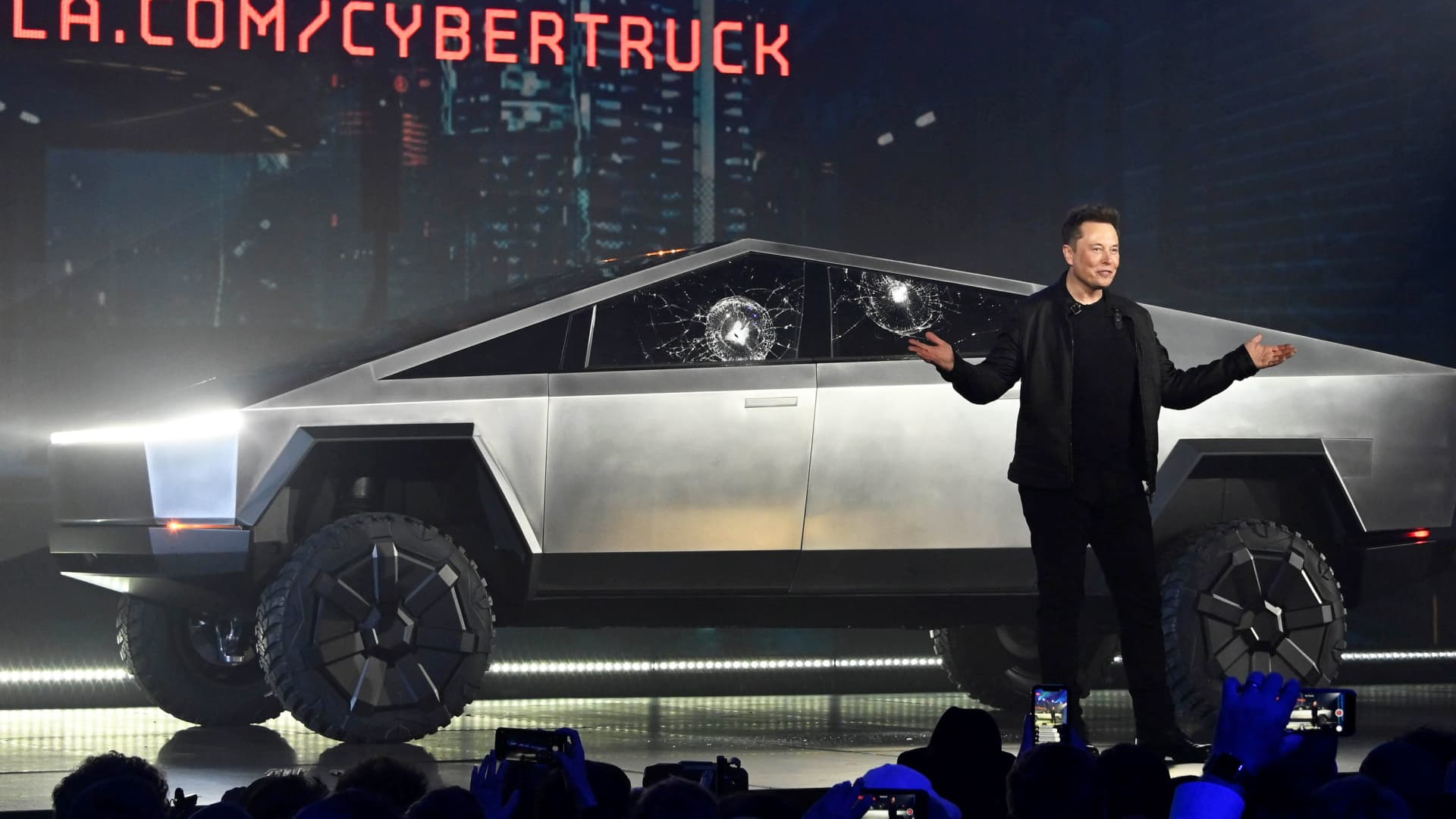 Tesla CEO Elon Musk unveils the Cybertruck at the TeslaDesign Studio in Hawthorne, Calif. The cracked window glass occurred during a demonstration on the strength of the glass.