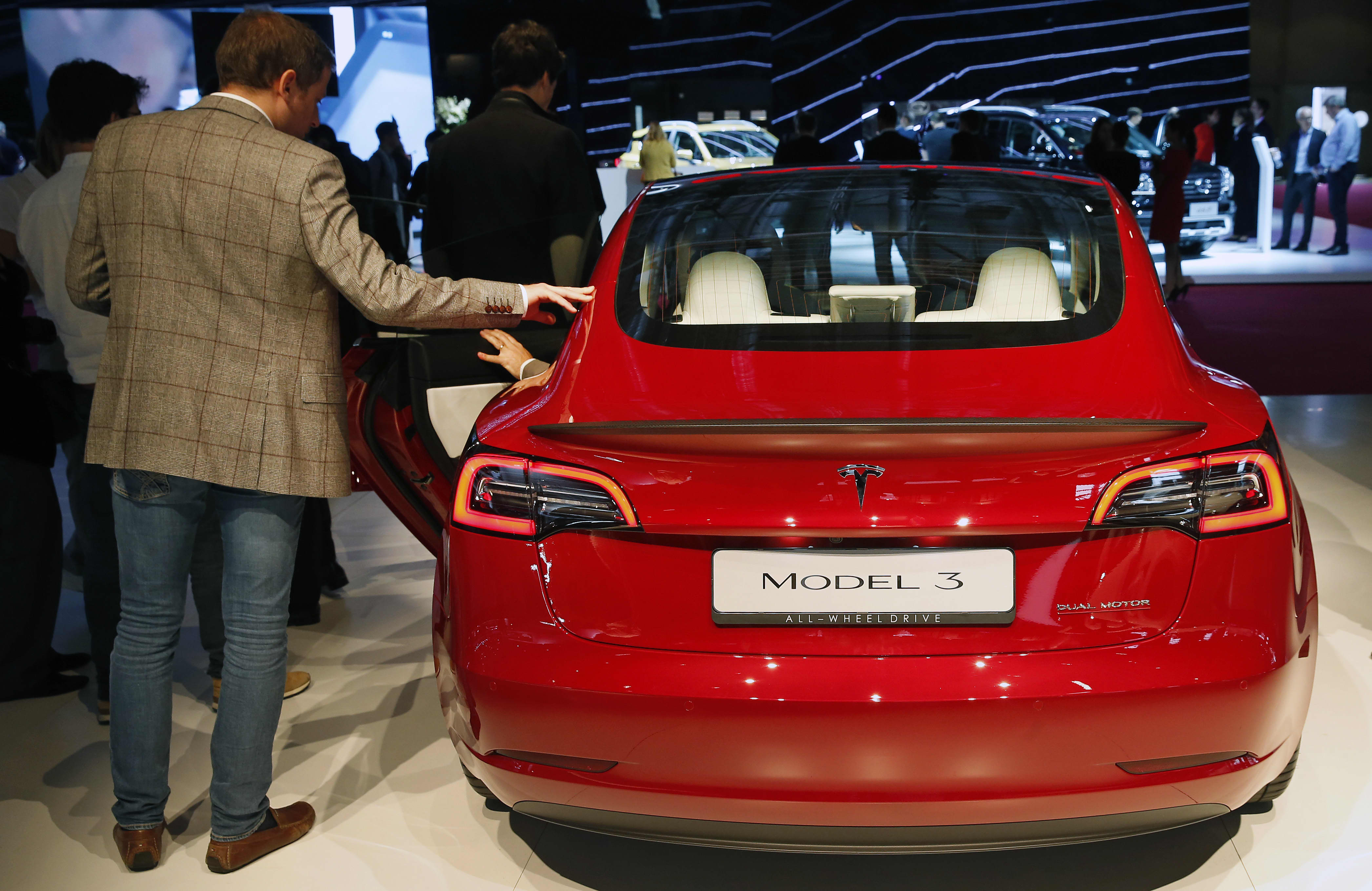 With Tesla up 55% in last 3 months, here's where two pros would buy in