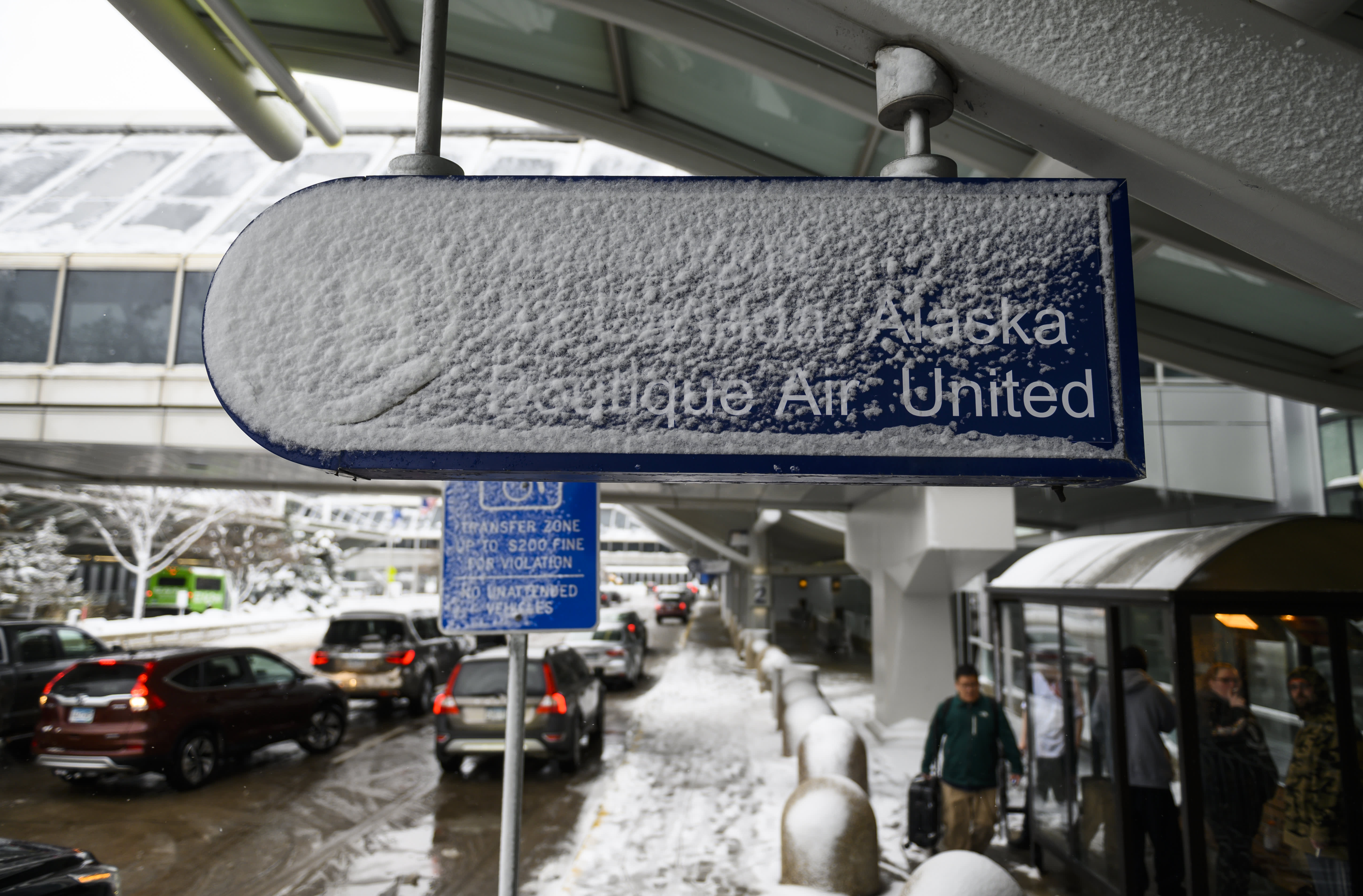 Hundreds of flights cancelled and thousands delayed as winter storm disrupts Thanksgiving travel