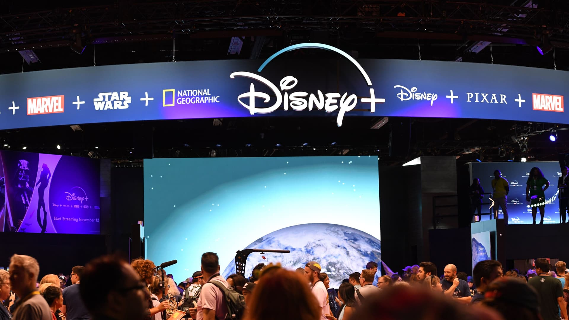 Attendees visit the Disney+ streaming service booth at the D23 Expo on August 23, 2019 at the Anaheim Convention Center in Anaheim, California.