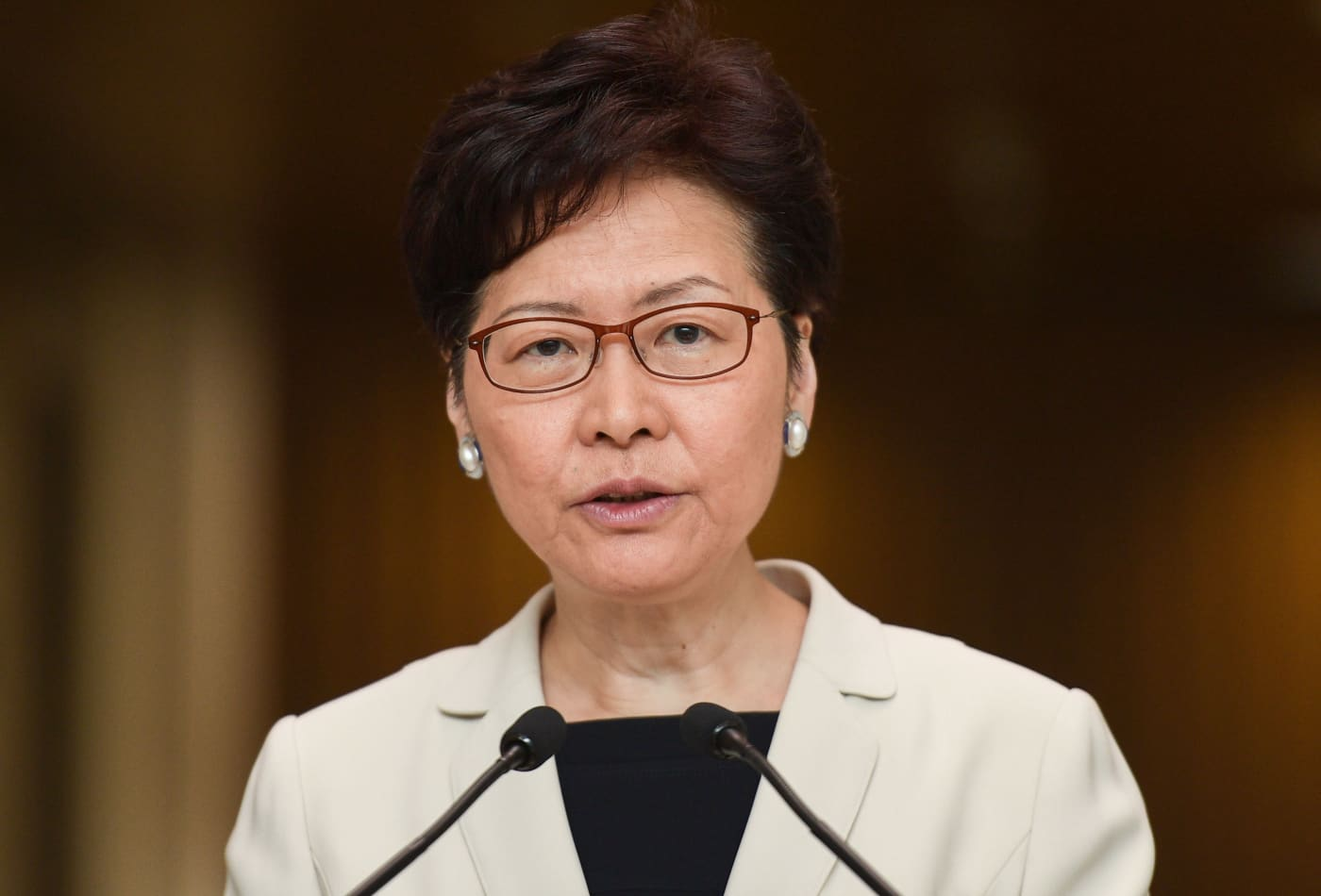Hong Kong leader Carrie Lam says she's 'very disappointed' by rating downgrade