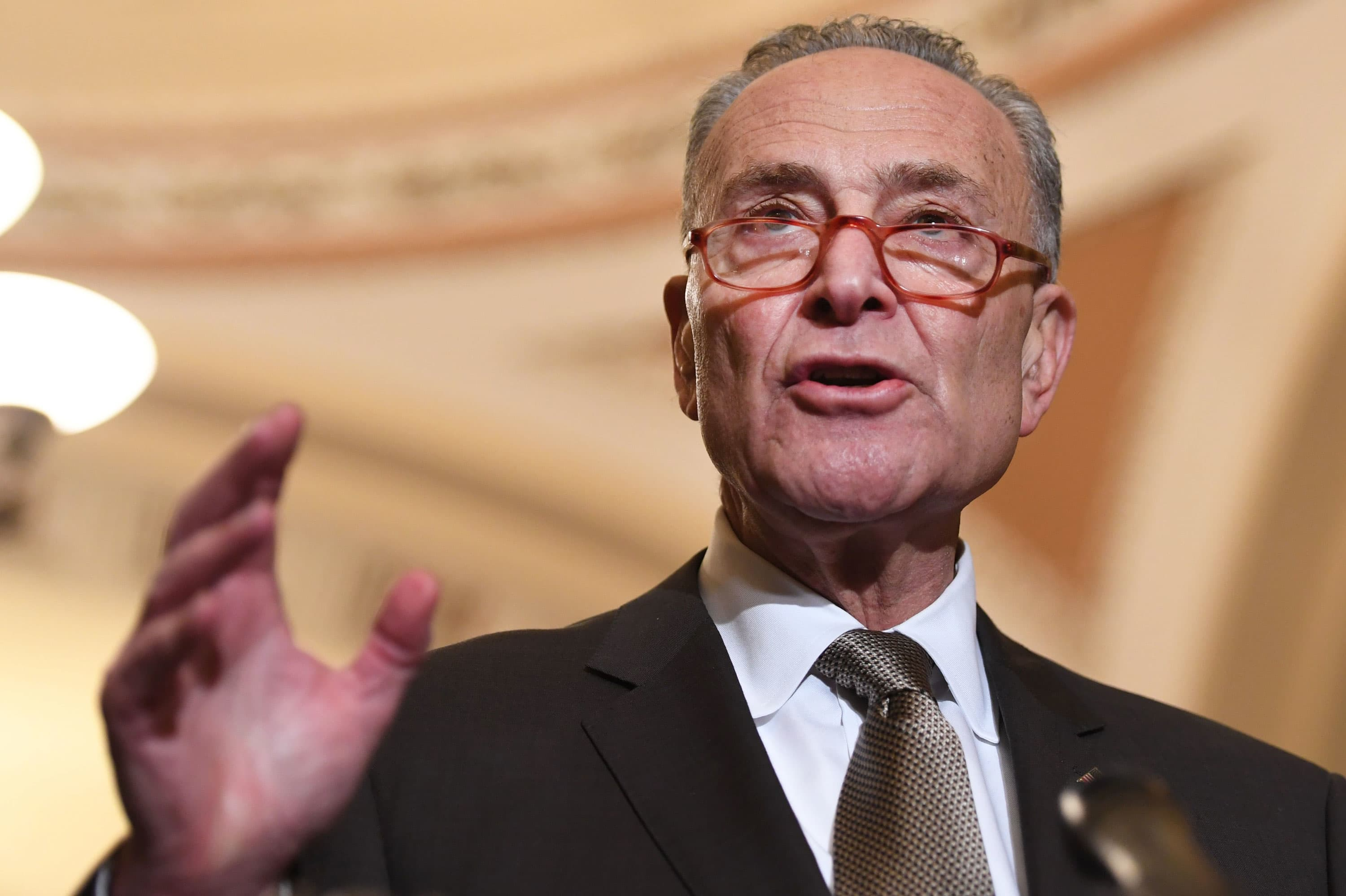 Chuck Schumer, one of Trump's biggest Democratic cheerleaders on China, says president 'sold out' in phase one deal