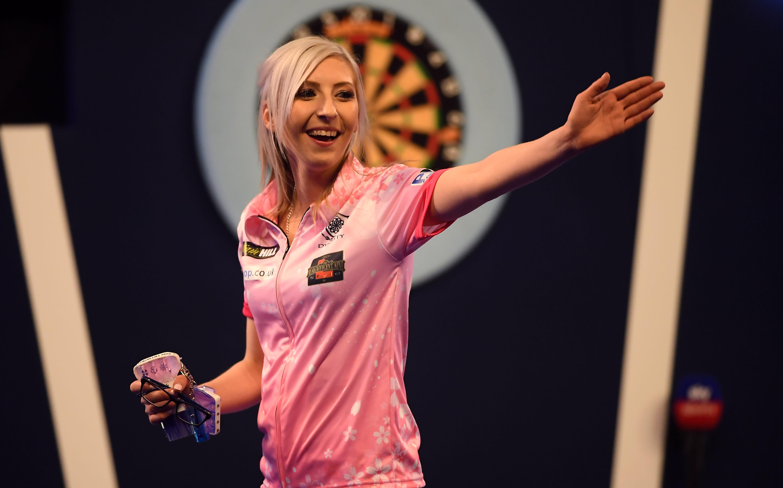 25-year-old Fallon Sherrock becomes first woman to win World Darts Championship match