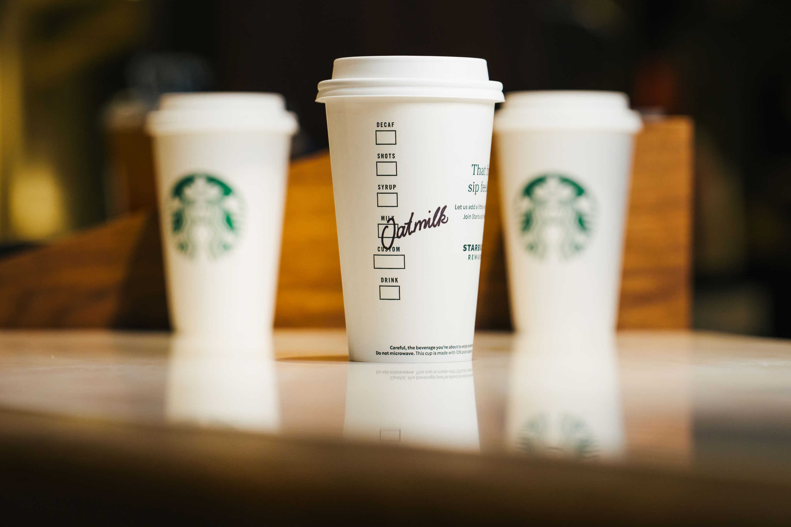 Starbucks shifts to 'to go' model, will close some cafes, shorten hours