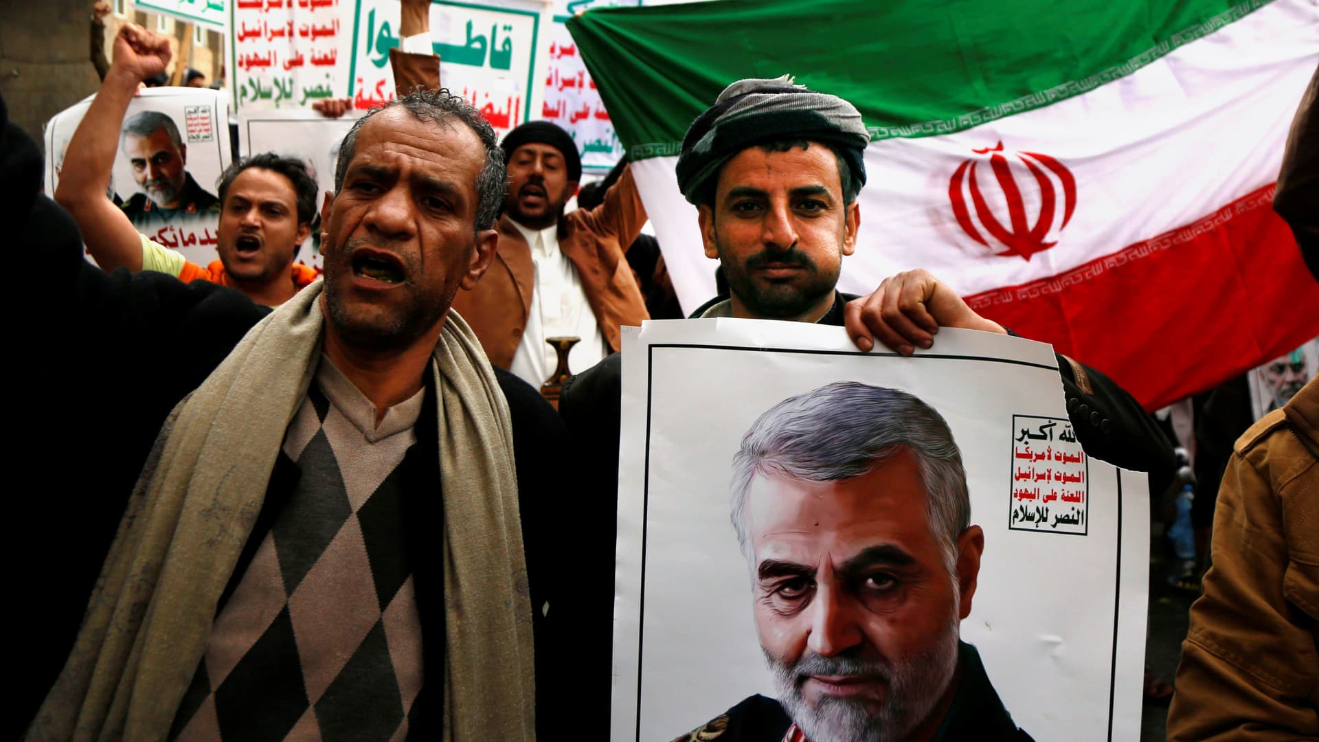 People gather to protest the US air strike in Iraq that killed Iranian commander Qasem Soleimani, who headed Iran's Revolutionary Guards' elite Quds force in Sanaa, Yemen on January 6, 2020.