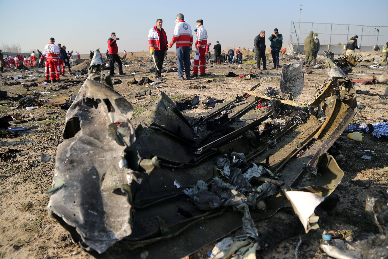 Ukrainian plane was on fire immediately before crash, Iran's initial probe says