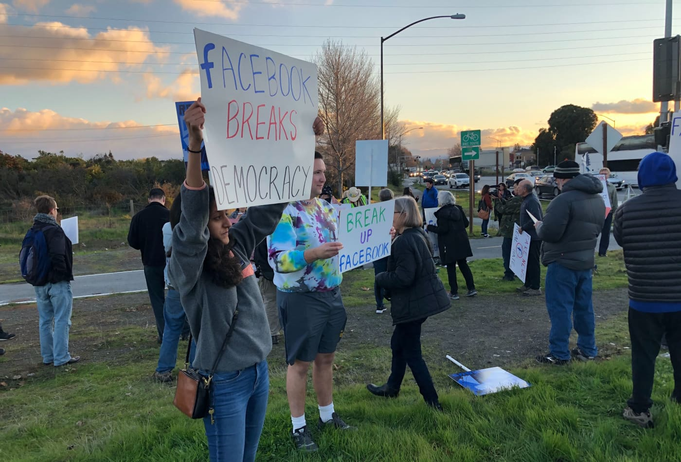 Protesters gather in front of Facebook HQ to decry its policy of allowing lies in political ads