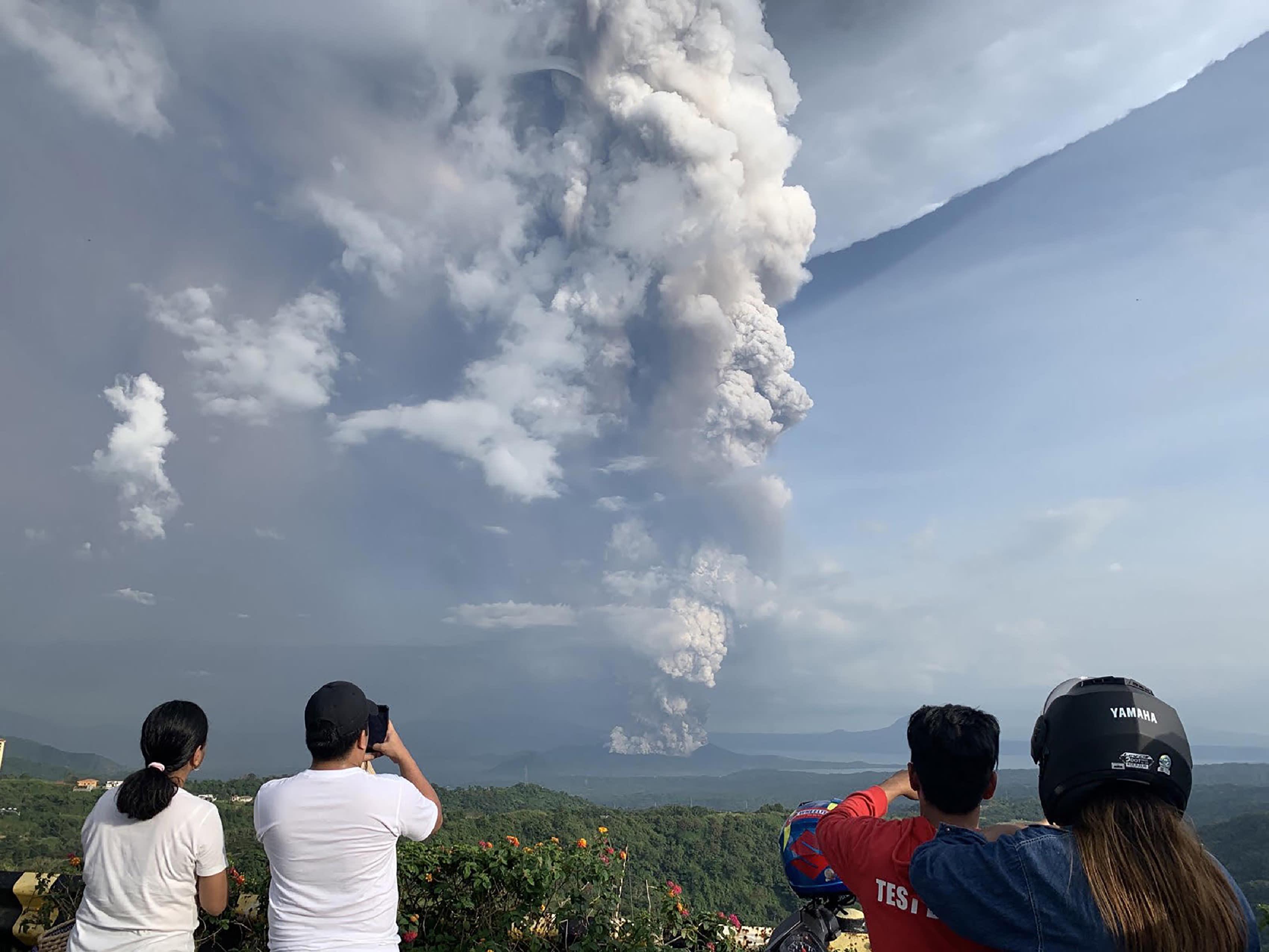 Philippines suspends Manila airport flights as volcano spews ash
