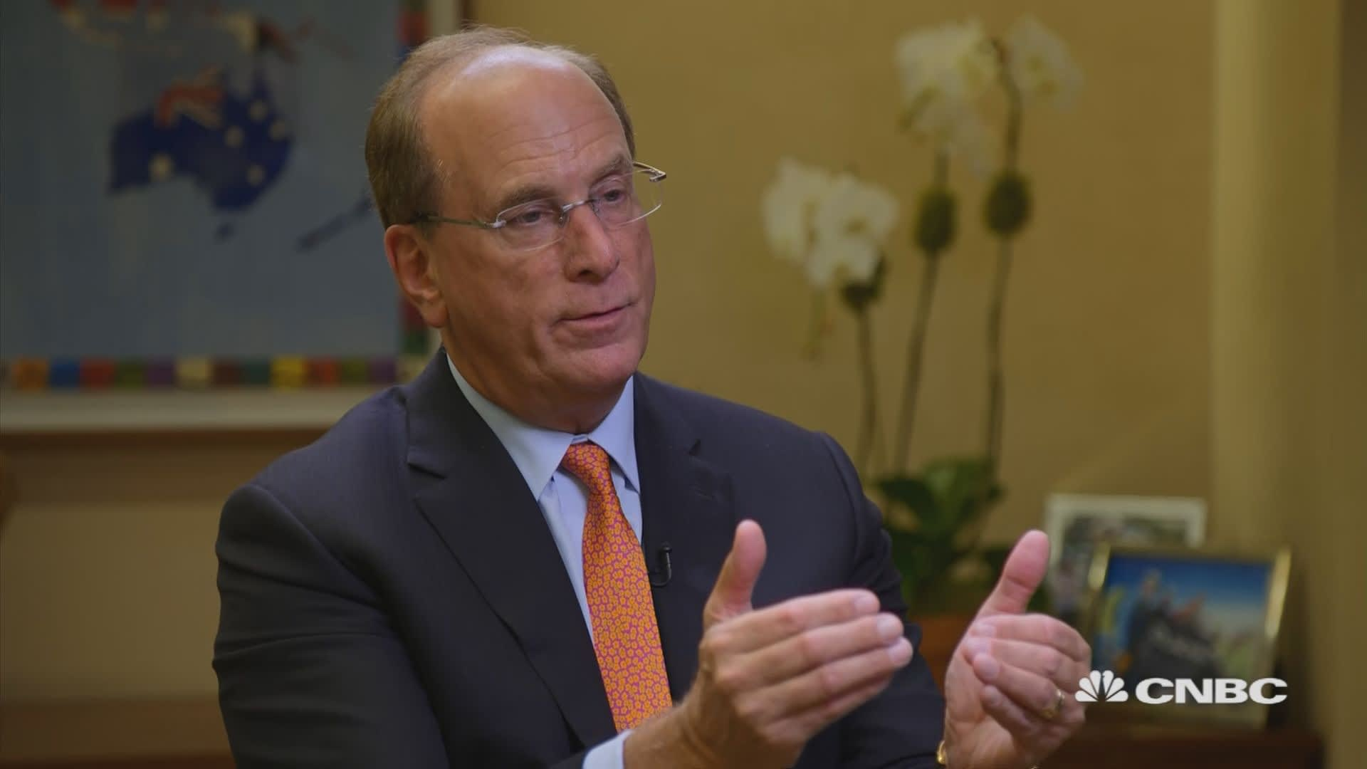 BlackRock CEO Larry Fink says climate change will soon reshape markets