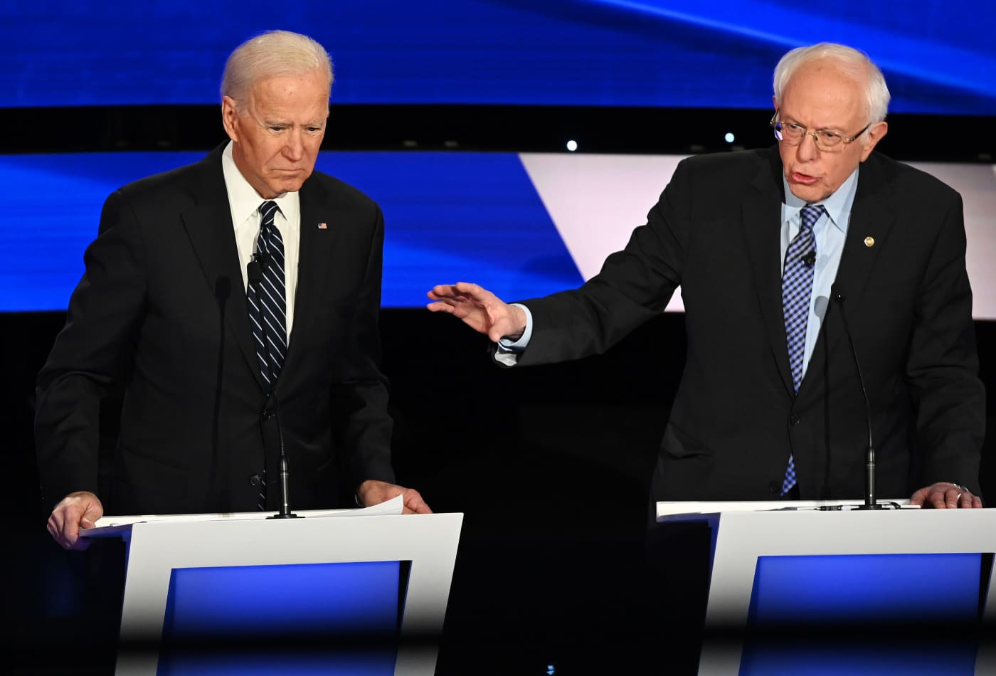 Bernie Sanders cuts into Joe Biden's polling lead, while Mike Bloomberg's cash burn helps him gain ground