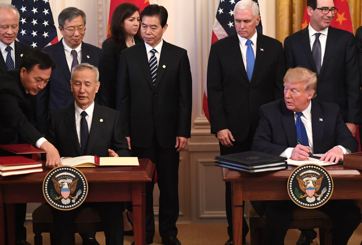 Trump signs 'phase one' trade deal with China in push to stop economic conflict