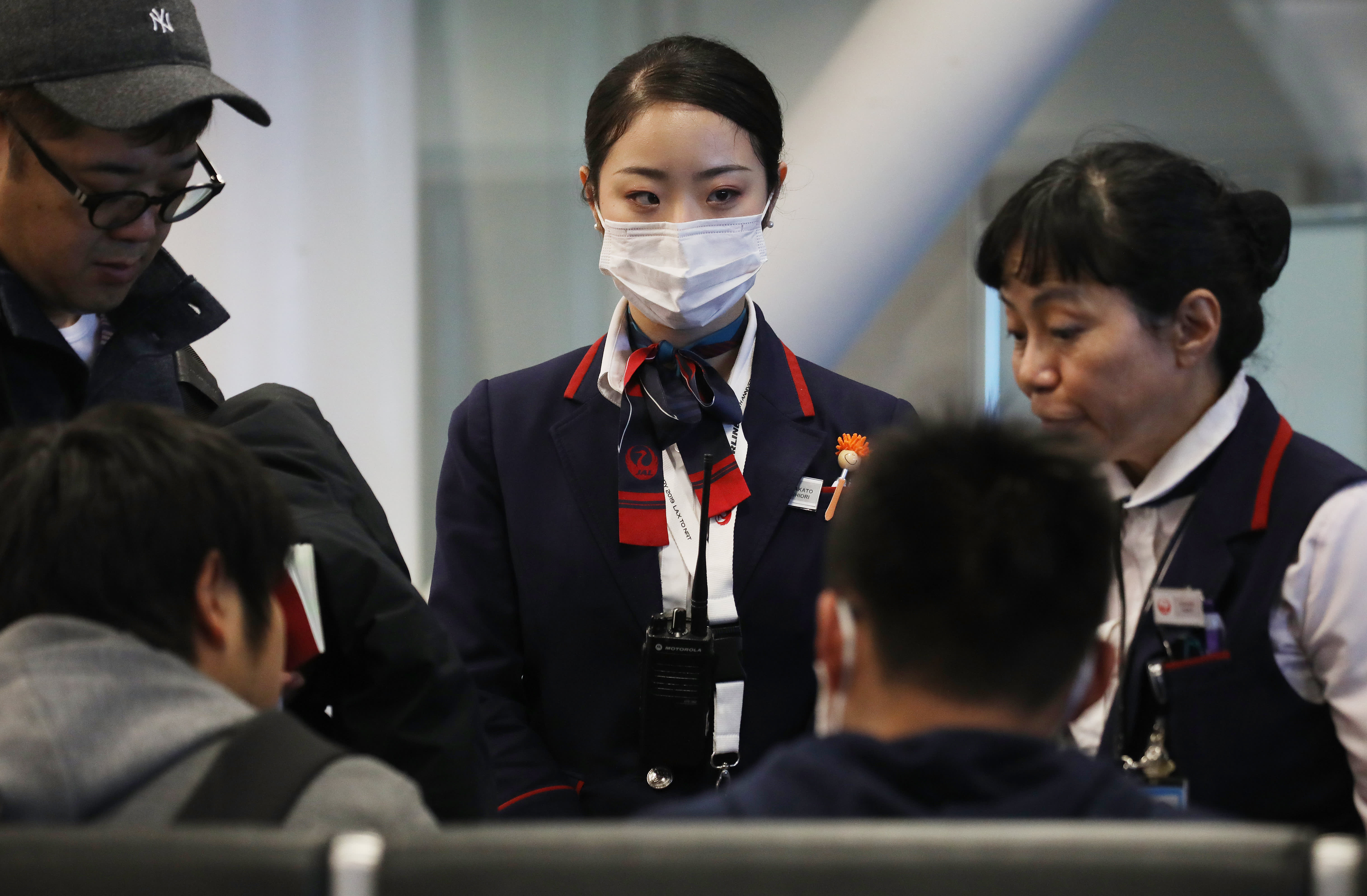 Global stock markets roiled as China's coronavirus spreads