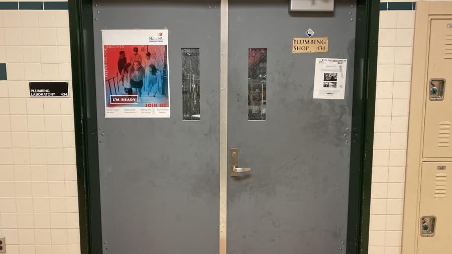 The door to plumbing shop 434