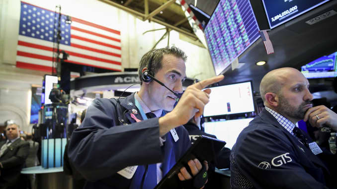 GP: Trader pointing on New York Stock Exchange floor