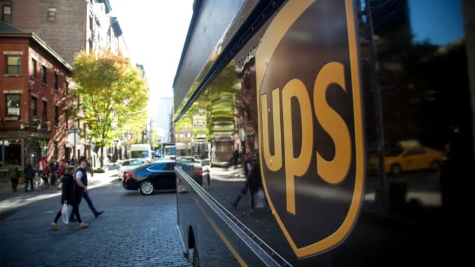 The United Parcel Service Inc. (UPS) logo is displayed on a truck parked in New York.