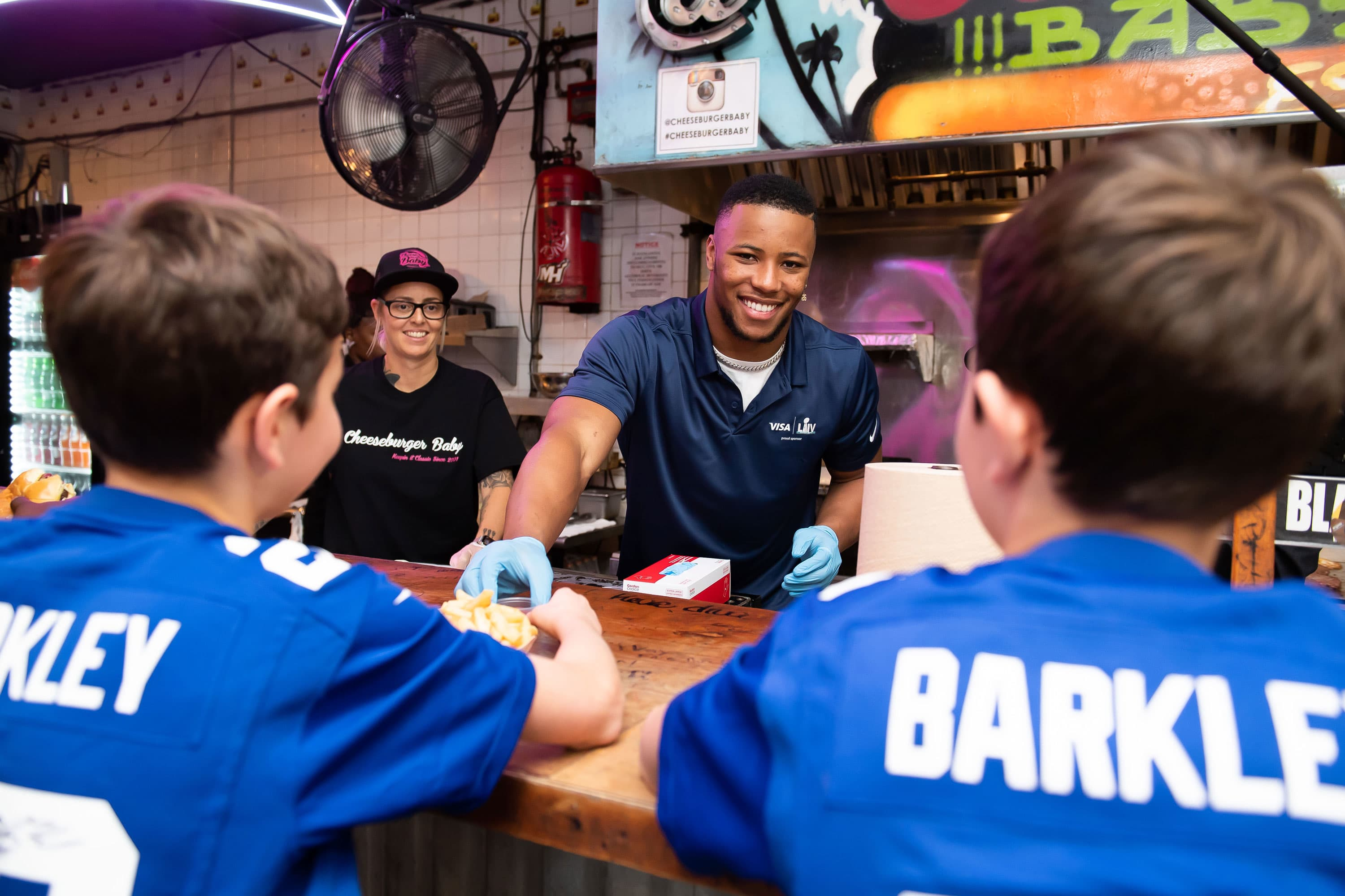 NFL star Saquon Barkley visits South Beach restaurant owner prepping Super Bowl tailgate, and gets inspired
