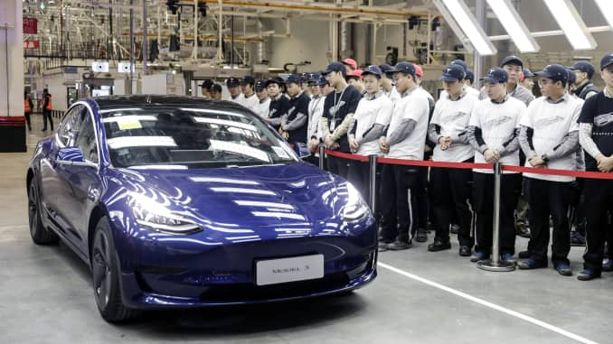A Tesla Model 3 vehicle set to be delivered to a company employee moves off an assembly line during a ceremony at the company's Gigafactory in Shanghai, China, on Monday, Dec. 30, 2019. Tesla spent over $1 billion in the most recent quarter on factories, including one in Germany, and Elon Musk has hinted that India could be the next target.