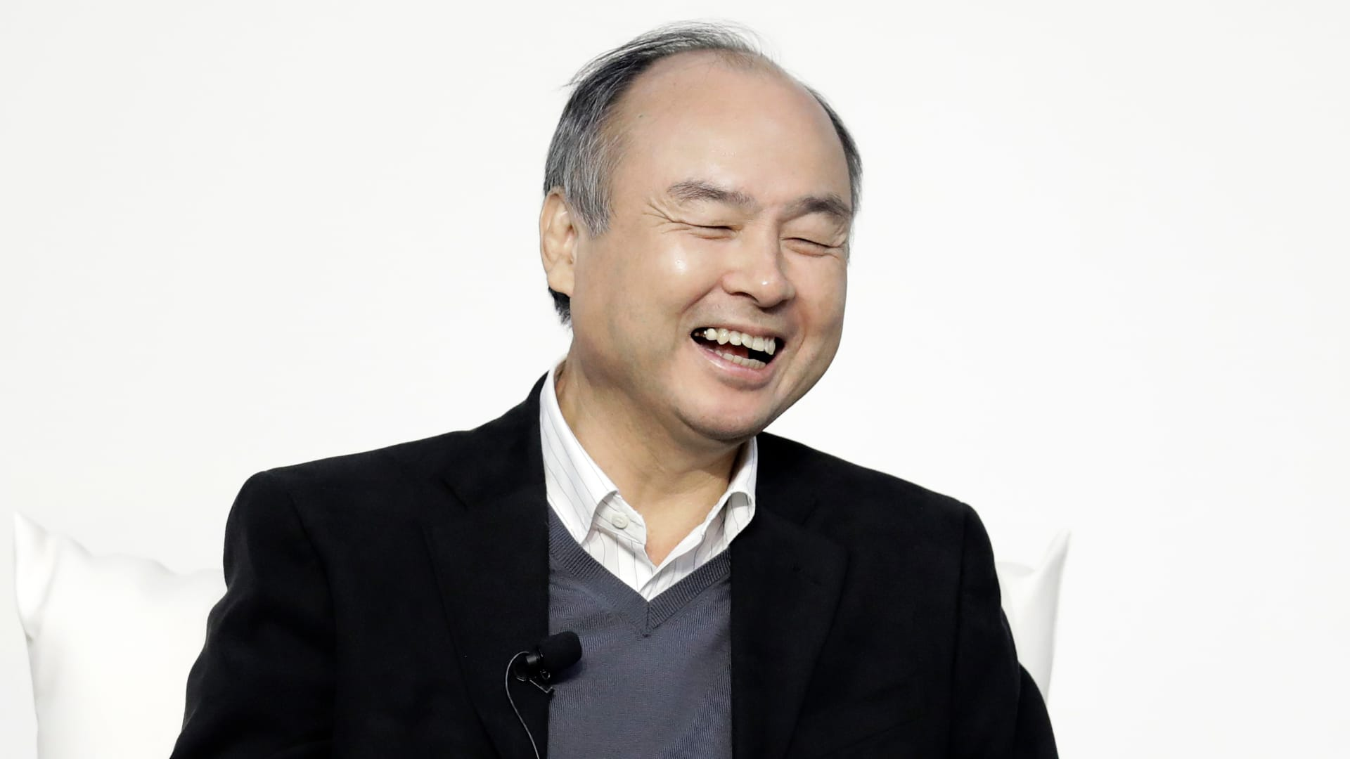 Masayoshi Son, chairman and chief executive officer of SoftBank, reacts during a dialog session with Jack Ma, former chairman of Alibaba, not pictured, at Tokyo Forum 2019 in Tokyo, Japan, on Friday, Dec. 6, 2019.
