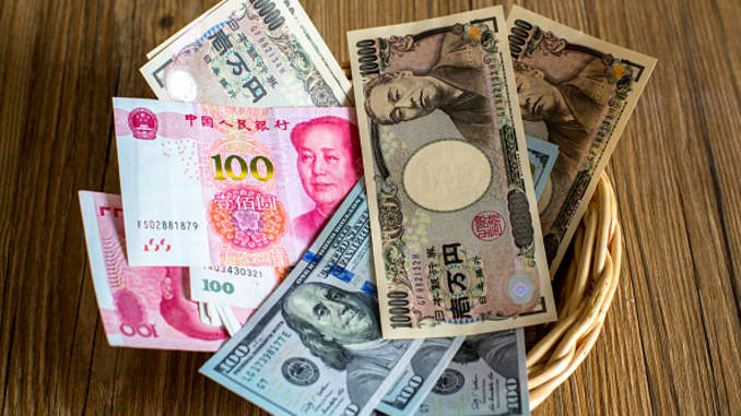 Bank notes of the Chinese yuan, Japanese yen and the U.S. dollar.