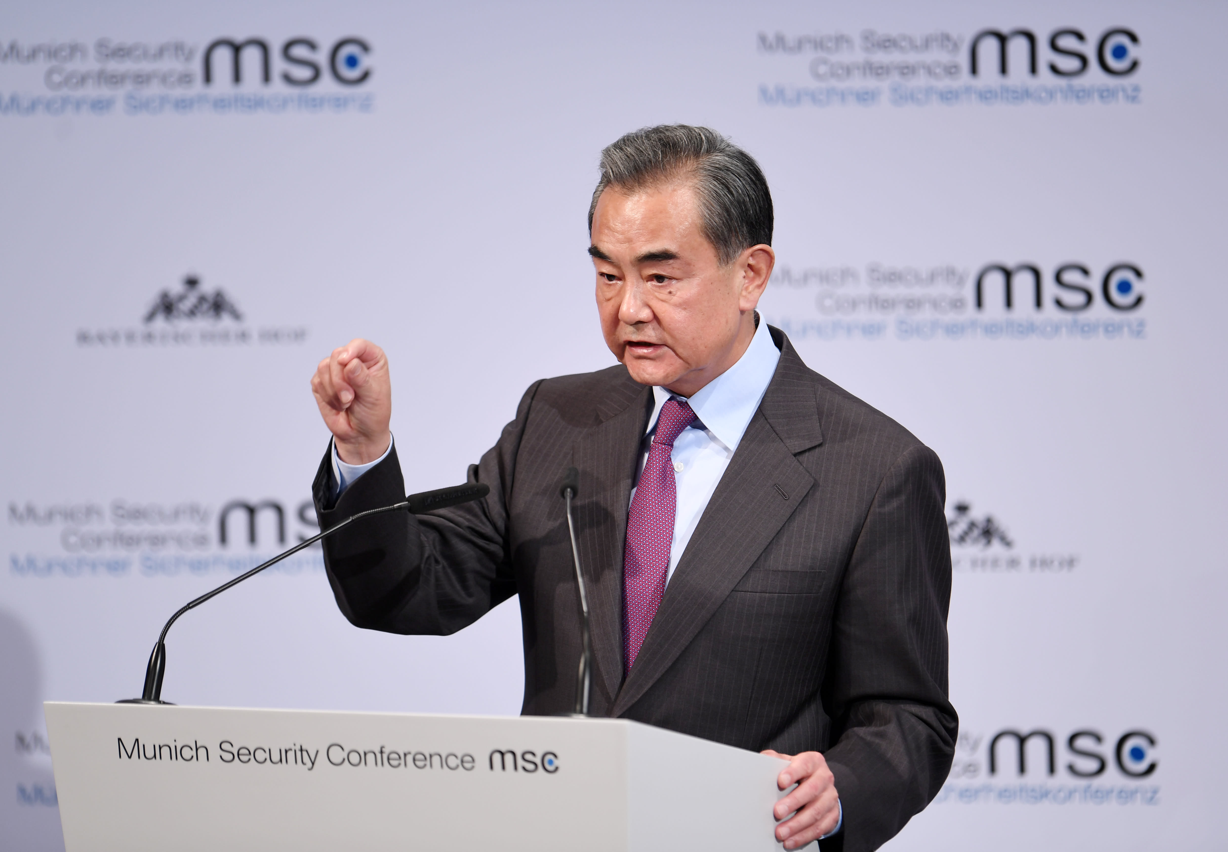 China's foreign minister denies major risks to Chinese economy as cases surge past 66,000