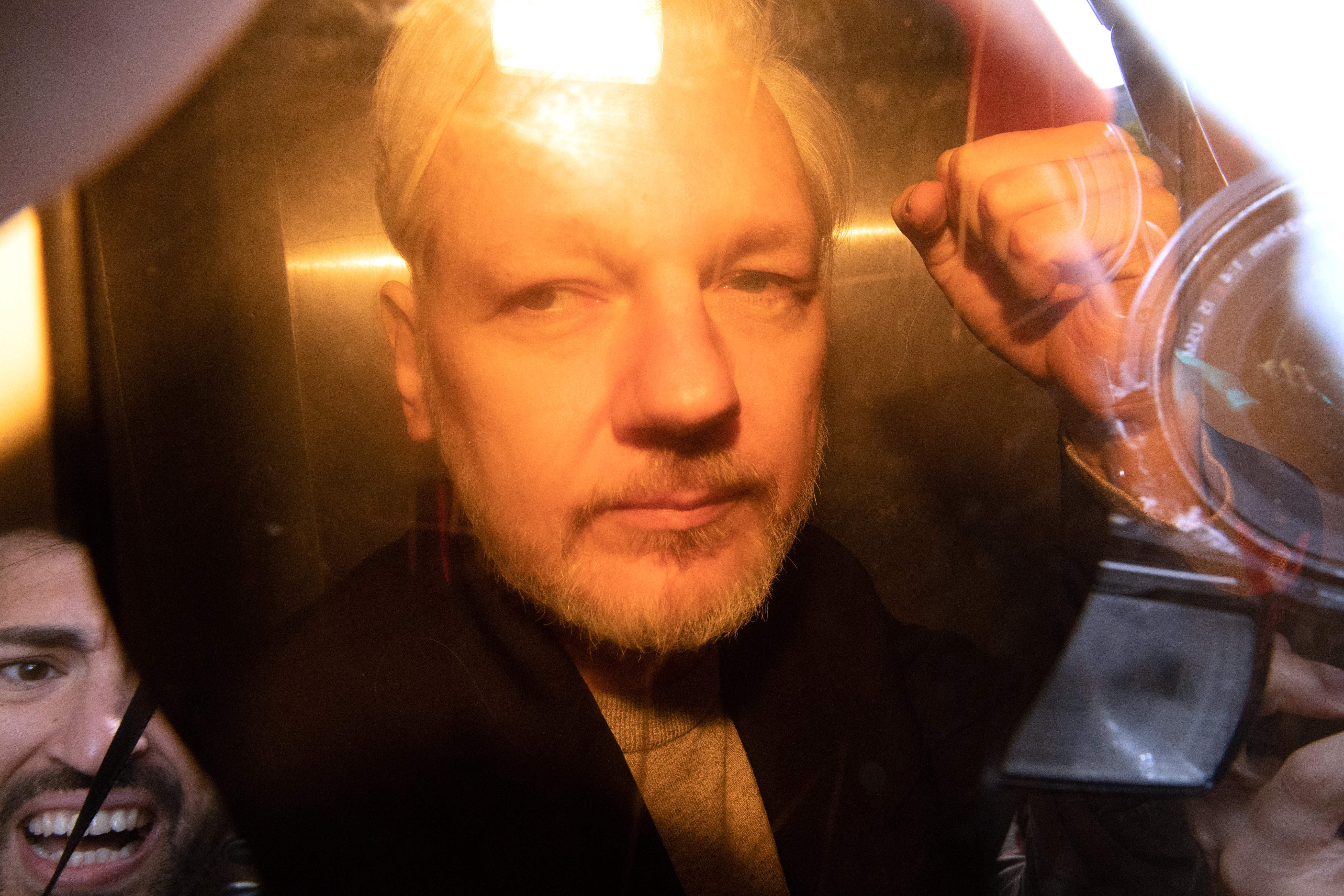 Trump offered WikiLeaks' Julian Assange a pardon if he covered up Russian hacking of Democrats, lawyer tells court