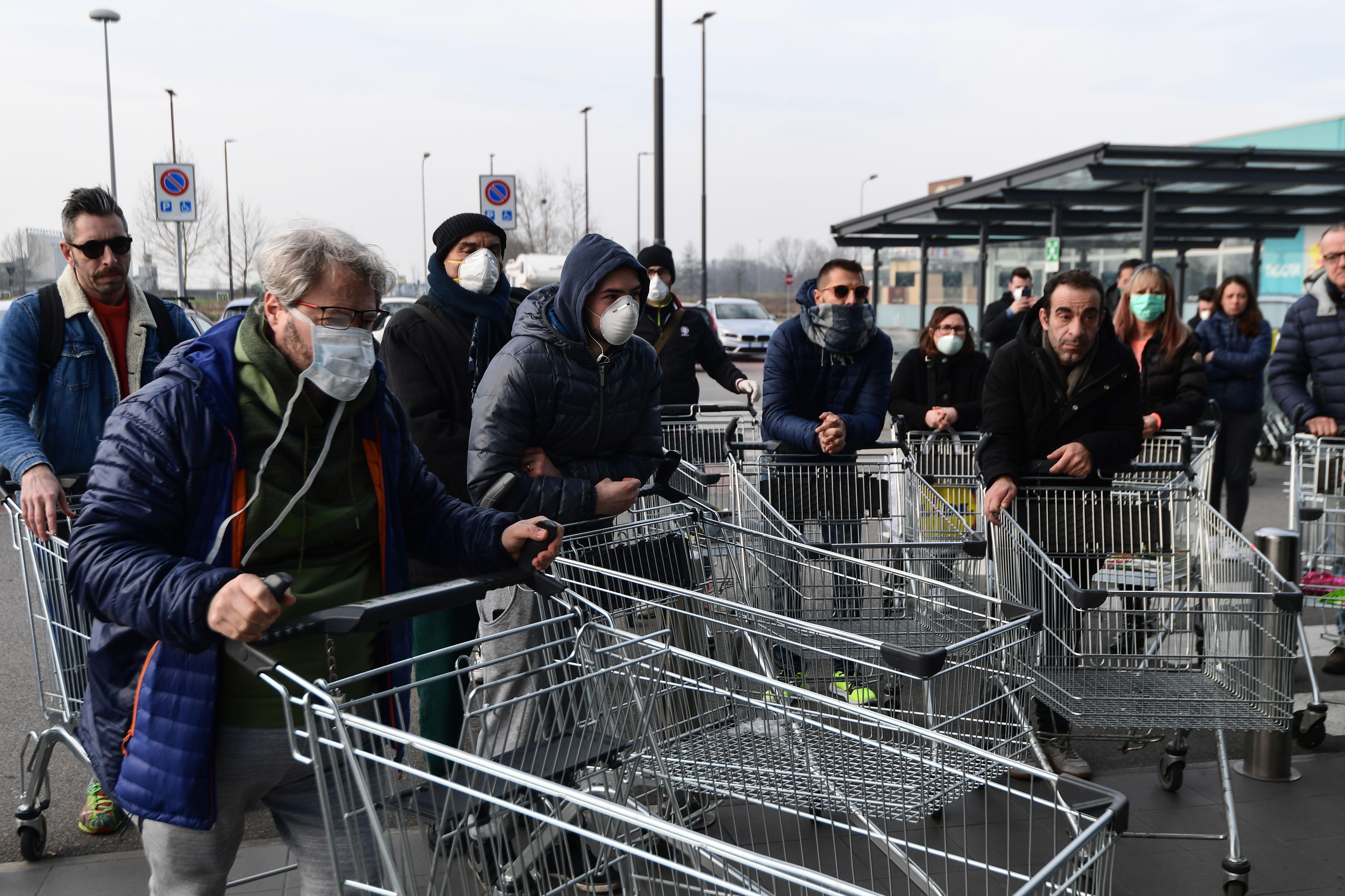 Italian stocks plunge 4% as coronavirus shuts down towns, schools and soccer matches