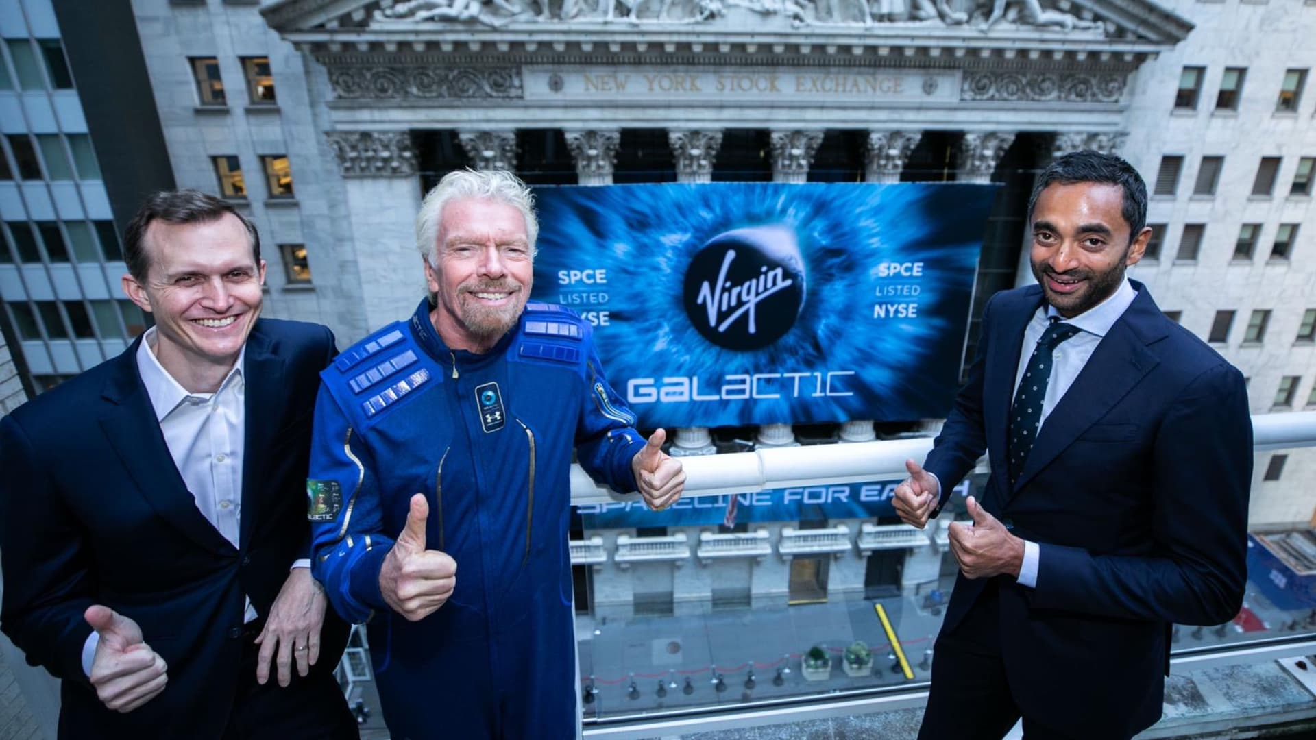 Virgin Galactic leaders in front of the New York Stock Exchange, from left: CEO George Whitesides, founder Richard Branson and Chairman Chamath Palihapitiya.