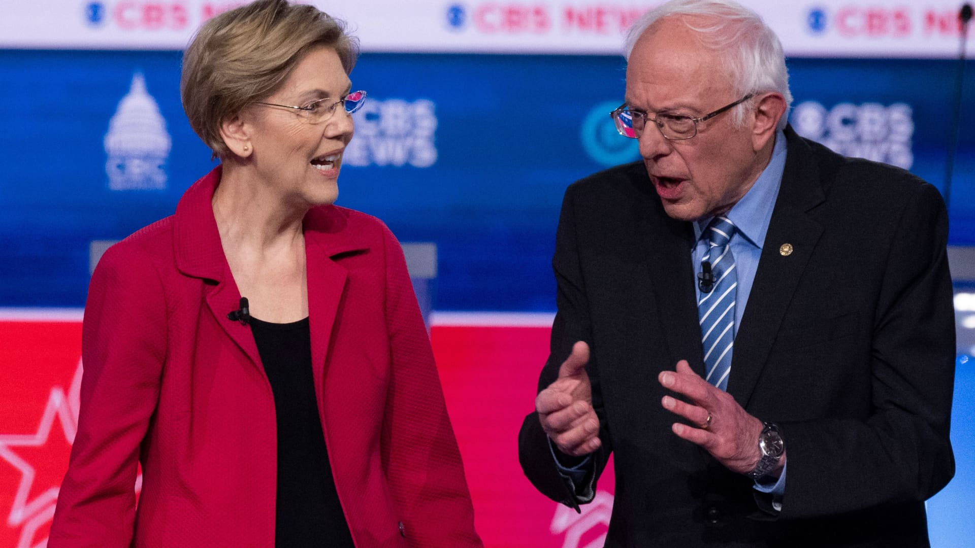 Democratic presidential hopefuls Massachusetts Senator Elizabeth Warren and Vermont Senator Bernie Sanders (R) chat ahead of the tenth Democratic primary debate of the 2020 presidential campaign season co-hosted by CBS News and the Congressional Black Caucus Institute at the Gaillard Center in Charleston, South Carolina, on February 25, 2020.