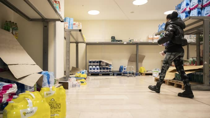 remium: PA woman walks in an empty supermarket. Precautionary...