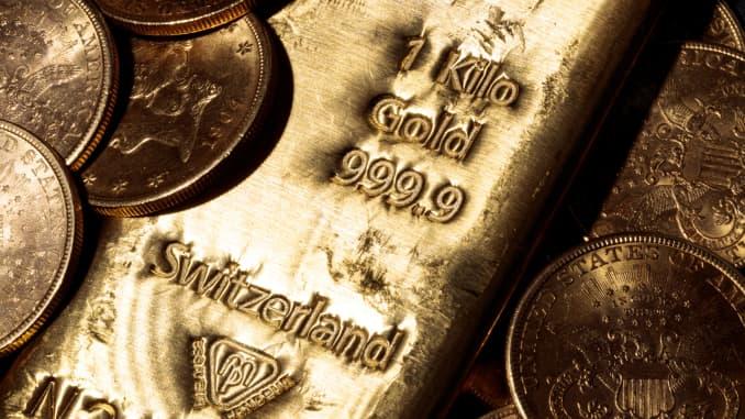 GP: Barra de ouro e moedas