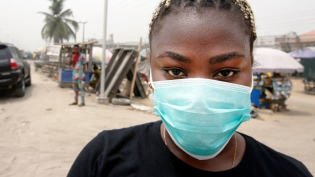 A local resident wears a protective face mask on the streets of Lagos, Nigeria, on Friday, Feb. 28, 2020. George Osodi | Bloomberg | Getty Images