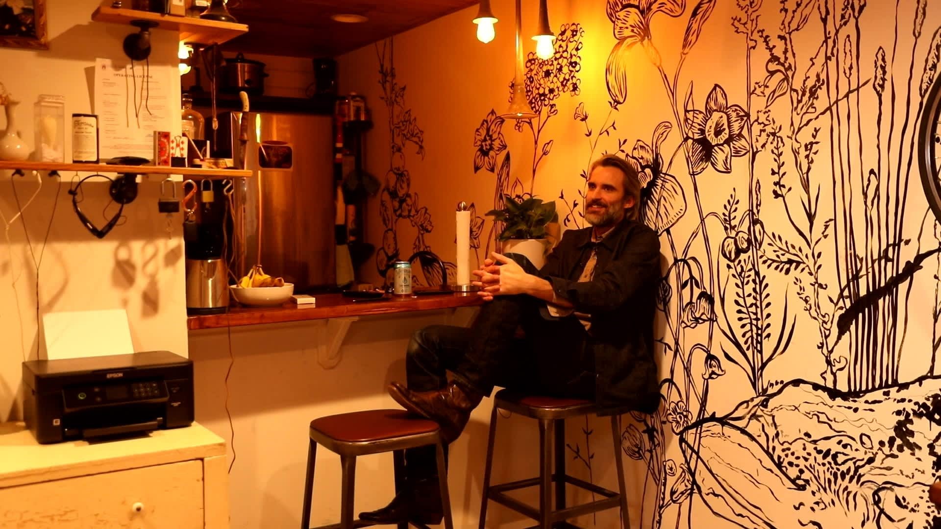 Bryce Dishongh relaxes in his condo.