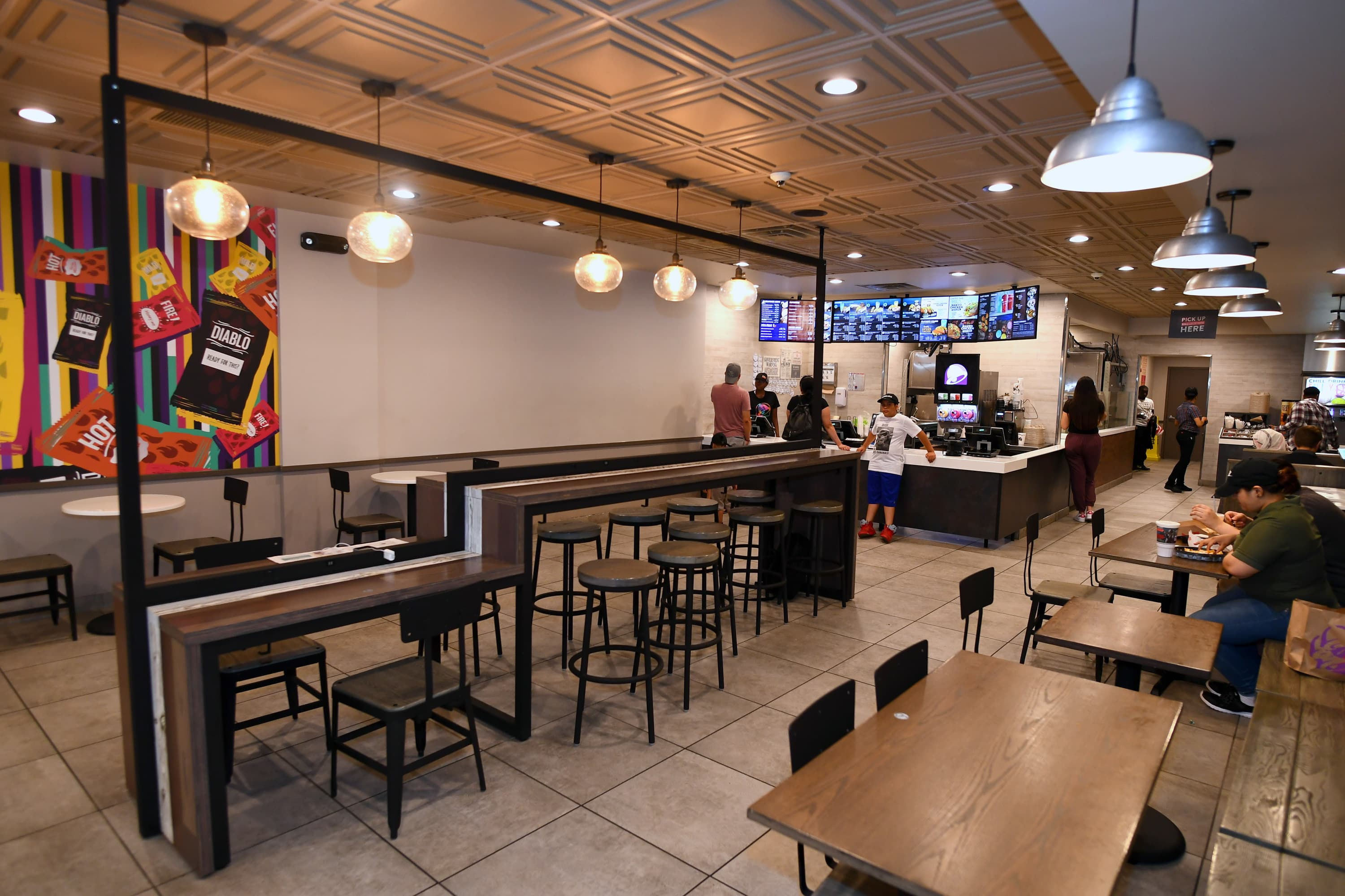 Taco Bell will test its alcohol-serving Cantina locations in the suburbs
