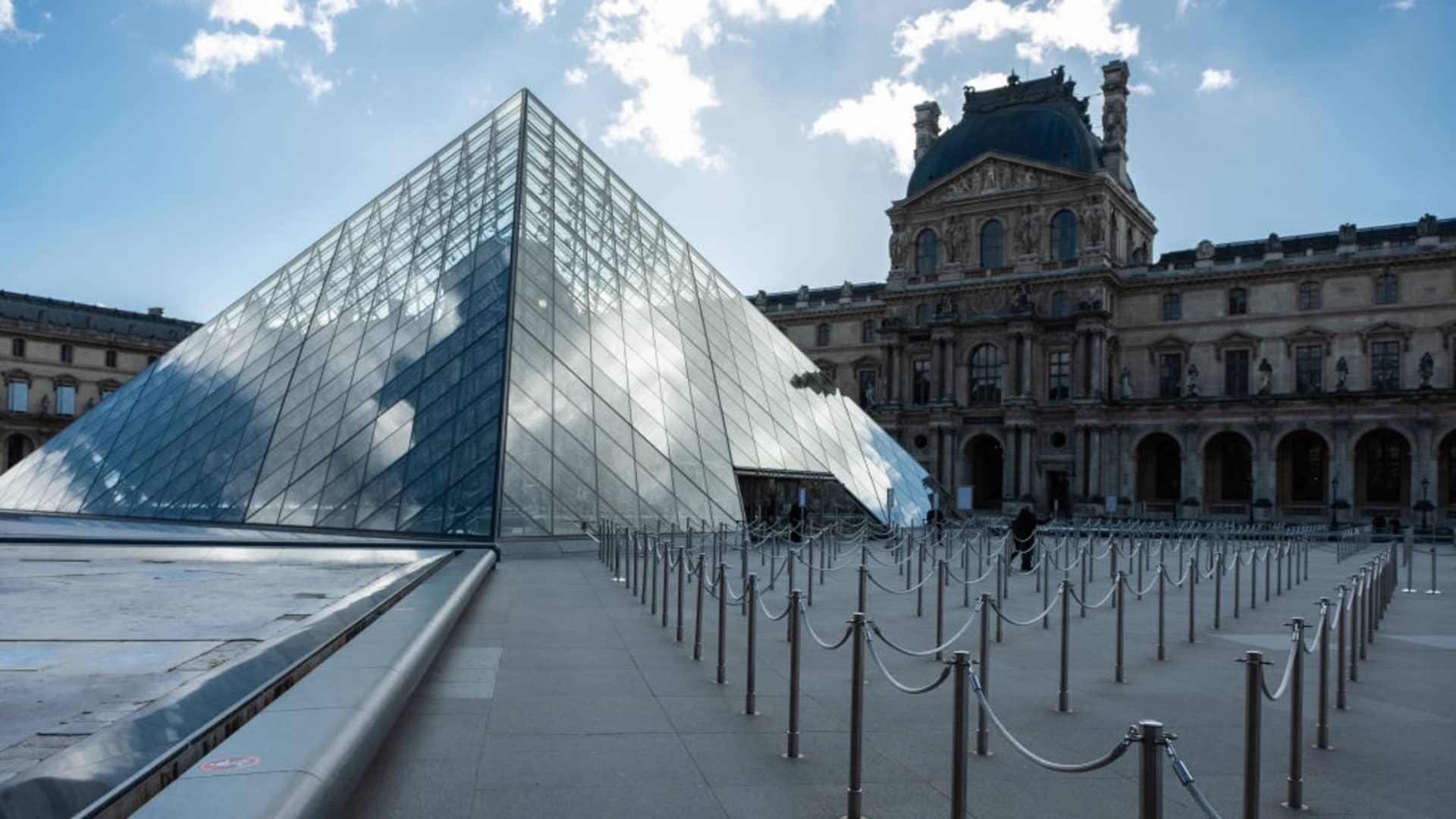 View of the Louvre museum quieter than ever in Paris, France, on March 13, 2020.