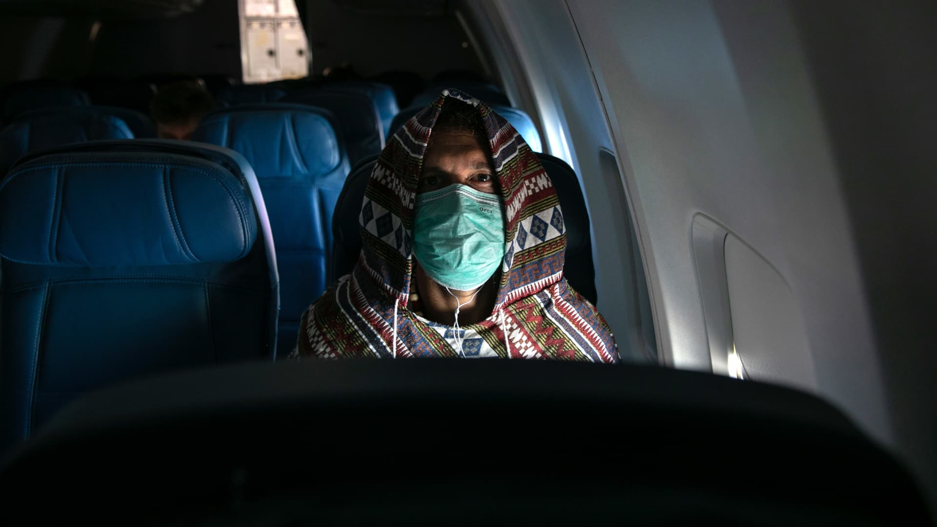 Adam Carver, 38, wears a mask to protect against coronavirus while on a nearly empty Delta flight from Seattle-Tacoma International Airport o JFK on March 15, 2020 near New York City.