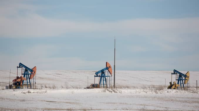 "Oil pumping jacks, also known as ""nodding donkeys"", operate in an oilfield near Almetyevsk, Tatarstan, Russia, on Wednesday, March 11, 2020."