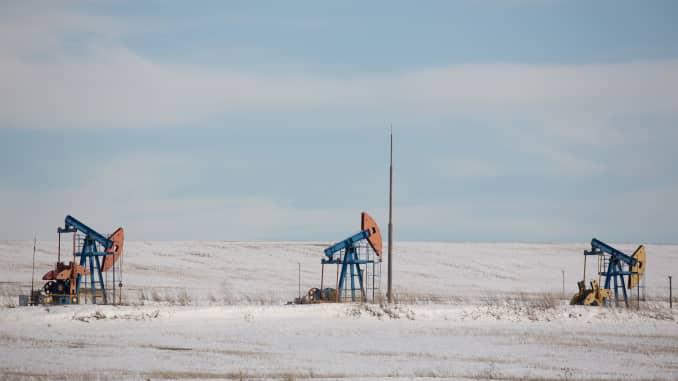 "Oil pumping jacks, also known as ""nodding donkeys"", operate in an oilfield near Almetyevsk, Tatarstan, Russia, on Wednesday, March 11, 2020."