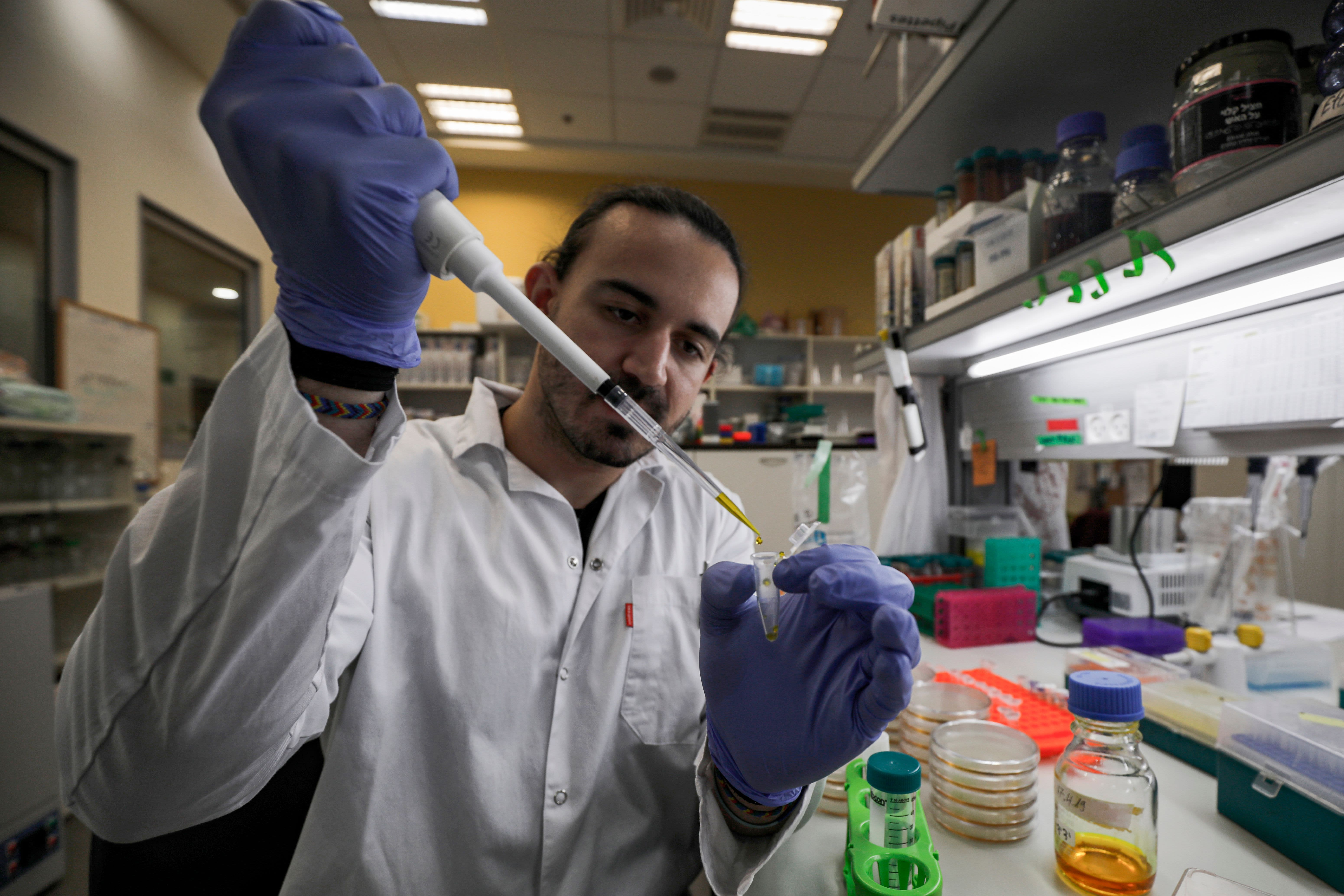 WHO officials say at least 20 coronavirus vaccines are in development in global race for cure