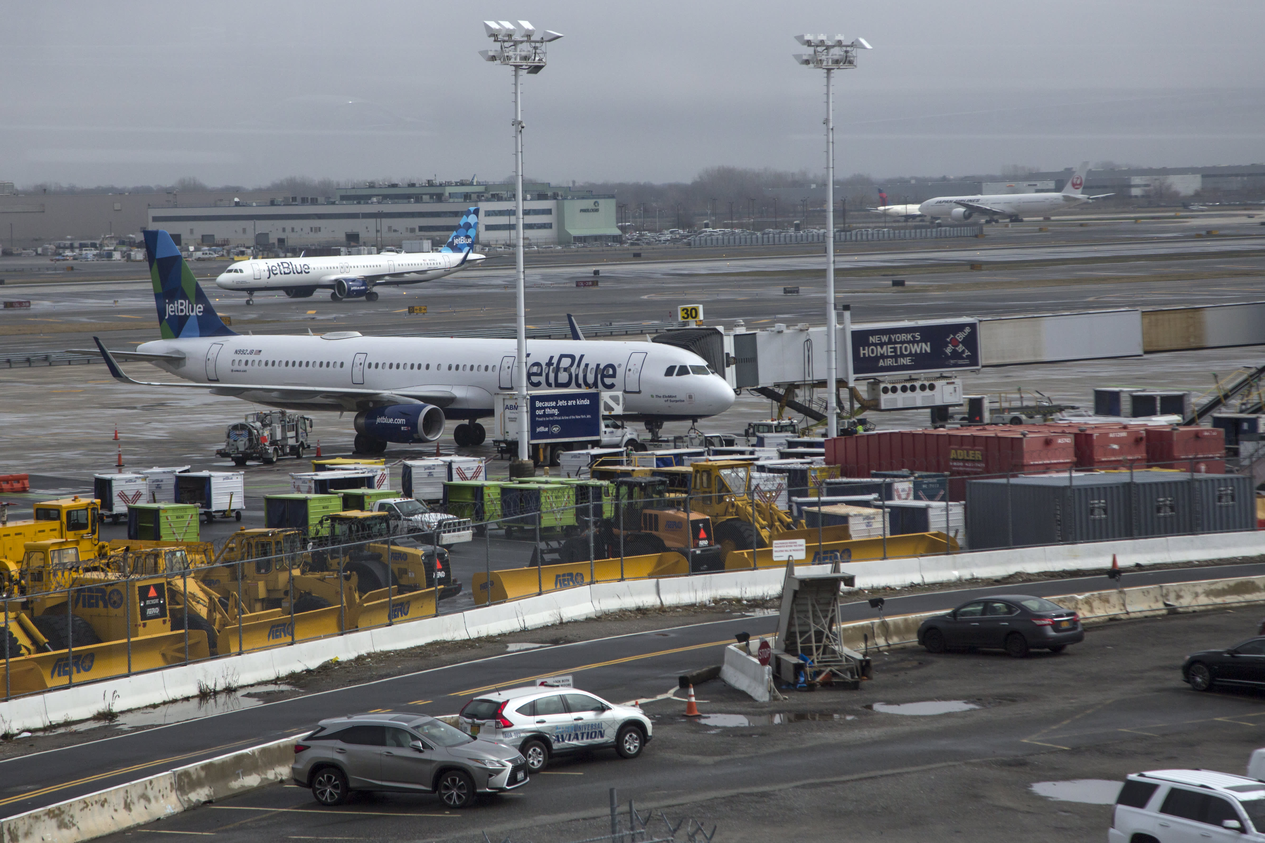 New York City area airports resume flights after brief halt as coronavirus causes staffing issues