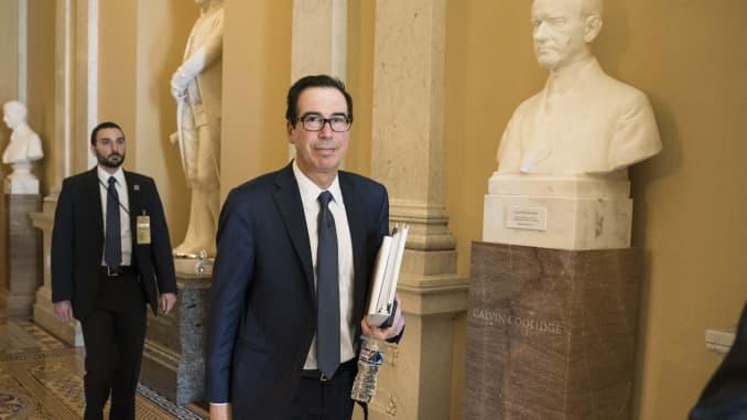 Steven Mnuchin, U.S. Treasury secretary, center, walks through the U.S. Capitol in Washington, D.C., U.S., on Sunday, March 22, 2020.