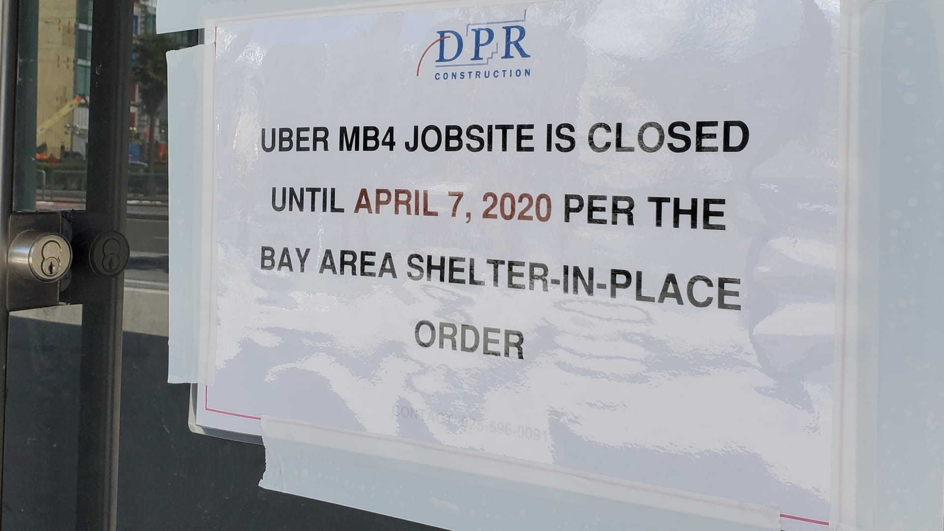 Sign on facade at jobsite for construction of new headquarters of Uber Inc announcing work stoppage and delays during an outbreak of the COVID-19 coronavirus in San Francisco, California, March 19, 2020.