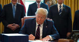 Trump signs $2 trillion coronavirus relief bill as the US tries to prevent economic devastation