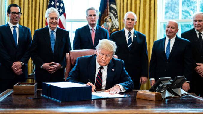 GP: President Trump Signs Coronavirus Stimulus Bill In The Oval Office - 106465023